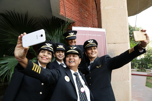 Air India women crew members share a light moment post the felicitation ceremony in New Delhi
