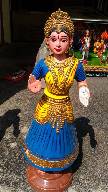 Thanjavur dolls or wooden dancing dolls that are famous throughout Andhra Pradesh