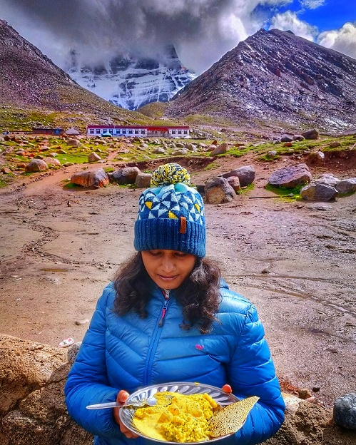 I got served with Sattvic Food during Kailash Mansarovar Yatra. Behind is the North Face of Mount Kailash